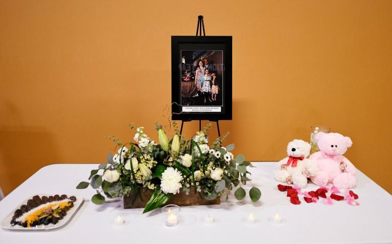 Mourners attend a service in memory of the victims of a Ukrainian passenger plane that crashed in Iran