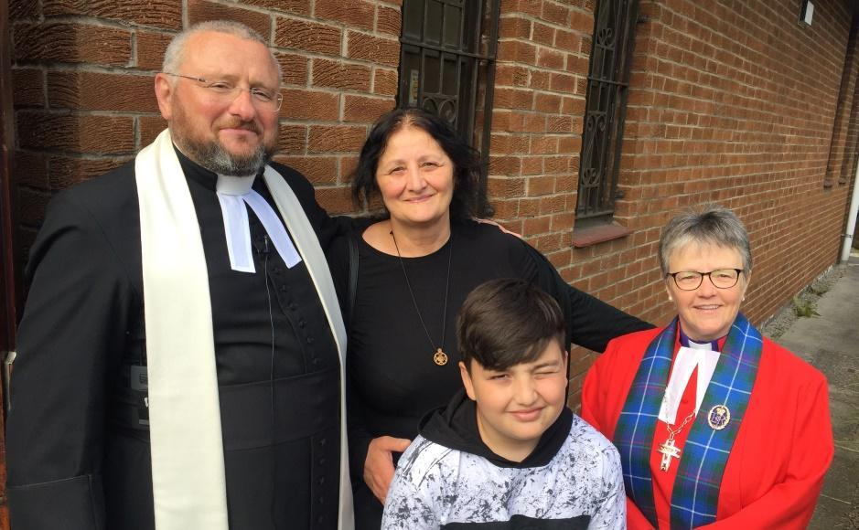 Giorgi with his grandmother and Church of Scotland ministers