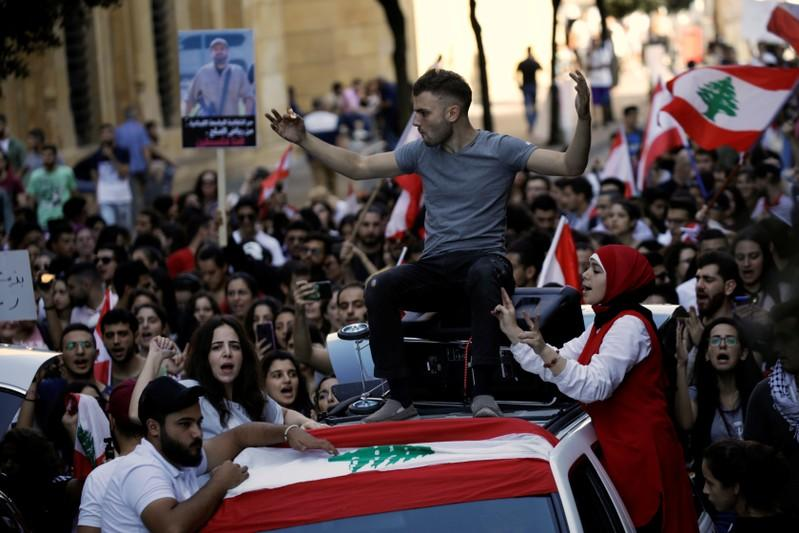 Protesters chant slogans as they march at a demonstration organised by students during ongoing anti-government protests in Beirut