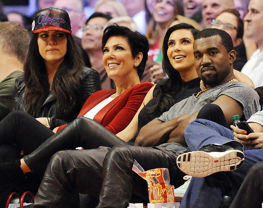 Kim Kardashian, Kanye West, Khloe Kardashian, Kris Jenner and Bruce Jenner watch the LA Clippers v Denver Nuggets NBA game at the Staples Center, Los Angeles, California.