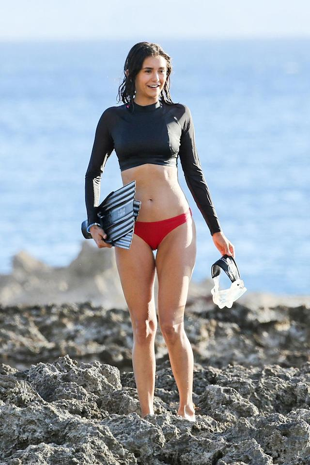 <p>Aloha, Nina! The star of the <i>Flatliners</i> reboot was working –- no, really! –- as she rocked a bikini in Honolulu. She was filming a video on the importance of sharks. (Photo: BACKGRID) </p>
