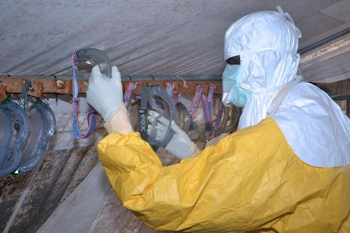 A healthworker wearing a protective suit pictured at an Ebola treatment centre in Conakry on December 8, 2014 (AFP Photo/Cellou Binani)