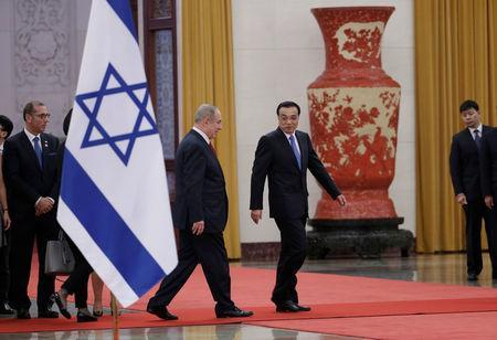 Israeli Prime Minister Benjamin Netanyahu and China's Premier Li Keqiang attend a welcoming ceremony at the Great Hall of the People in Beijing, China March 20, 2017. REUTERS/Jason Lee