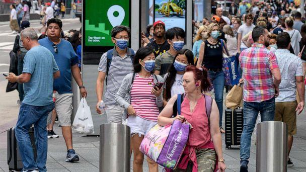 PHOTO: In this July 13, 2021, file photo, people walk through Times Square in New York. (Angela Weiss/AFP via Getty Images)