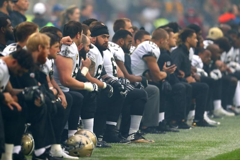 New Orleans Saints players kneel in protest ahead of a 2017 season game. Pic: Getty