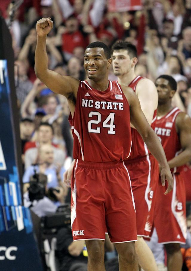 North Carolina State's T.J. Warren (24) celebrates during the second half of a quarterfinal NCAA college basketball game against Syracuse at the Atlantic Coast Conference tournament in Greensboro, N.C., Friday, March 14, 2014. North Carolina State won 66-63. (AP Photo/Bob Leverone)
