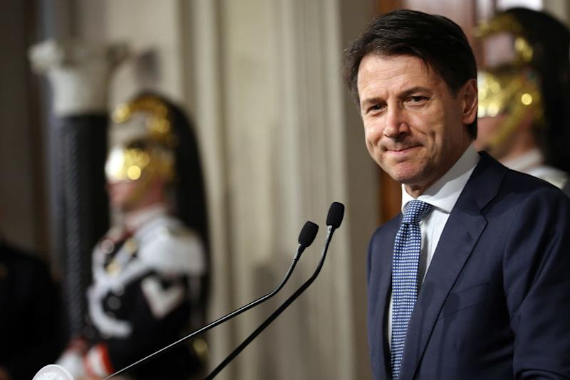 Italy president names ex-IMF official as interim PM to form government