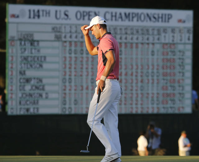 Martin Kaymer, of Germany, tips his cap after finishing the third round of the U.S. Open golf tournament in Pinehurst, N.C., Saturday, June 14, 2014. (AP Photo/Matt York)