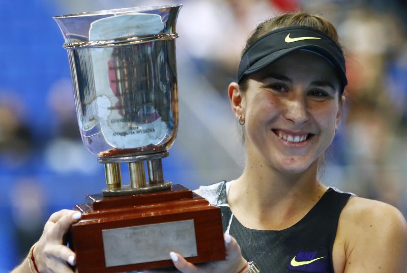 Belinda Bencic of Switzerland holds her trophy after victory over Anastasia Pavlyuchenkova of Russia in the final match of the Kremlin Cup tennis tournament in Moscow, Russia, Sunday, Oct. 20, 2019. (AP Photo/Alexander Zemlianichenko)