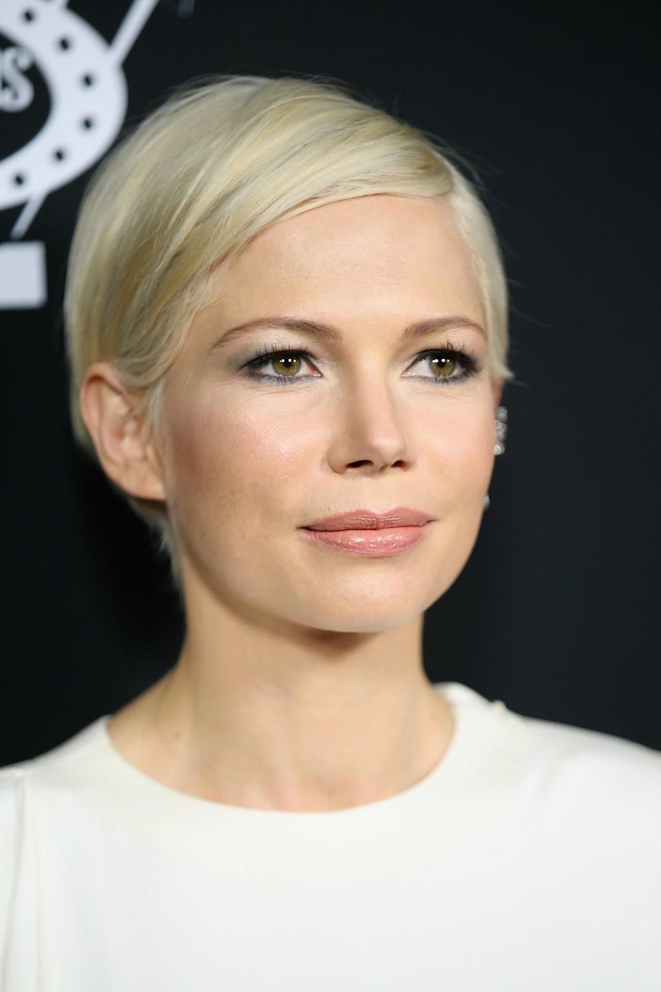 <p>We all got a bit of a shock at first when Michelle Williams debuted a sleek peroxide pixie cut but now we couldn't imagine her without it. [Photo: Getty] </p>