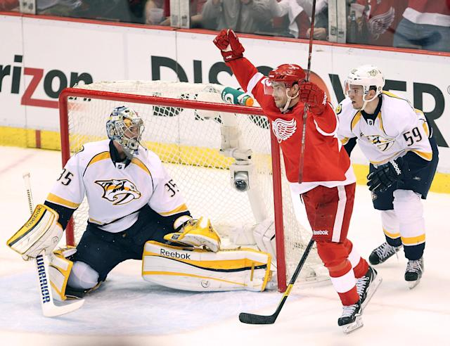 DETROIT, MI - APRIL 15: Pavel Datsyuk #13 of the Detroit Red Wings celebrates a second period goal in front of Pekka Rinne #35 and Roman Josi #59 of the Nashville Predators during Game Three of the Western Conference Quarterfinals during the 2012 NHL Stanley Cup Playoffs at Joe Louis Arena on April 15, 2012 in Detroit, Michigan. (Photo by Gregory Shamus/Getty Images)
