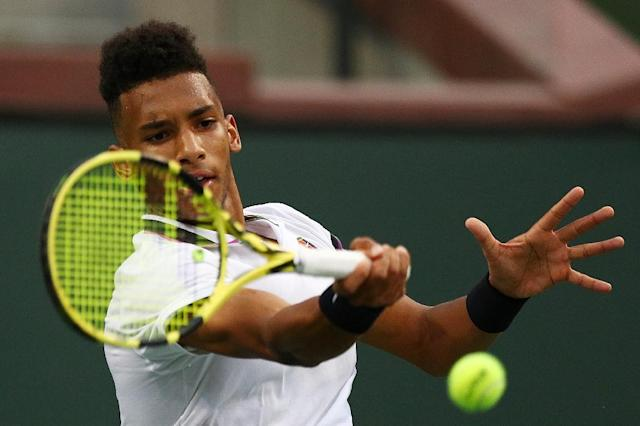 Canada's Felix Auger-Aliassime's comeback bid falls short in a third-round loss to Japan's Yoshihito Nishioka in a third round match at the ATP Indian Wells Masters (AFP Photo/Yong Teck Lim)