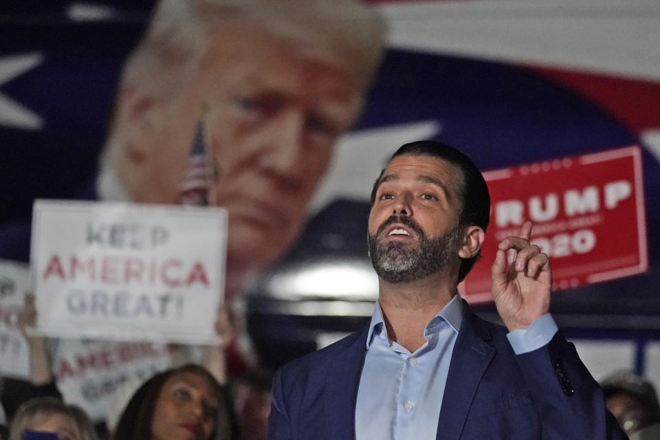 FILE - In this Nov. 5, 2020, file photo Donald Trump Jr., gestures during a news conference at Georgia Republican Party headquarters in Atlanta. A spokesman says President Donald Trump's eldest son, Donald Trump Jr., has been infected with the coronavirus. The spokesman says the younger Trump learned his diagnosis earlier this week, has no symptoms and has been quarantining. (AP Photo/John Bazemore, File)