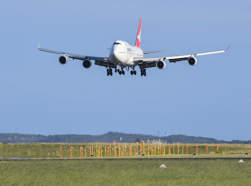 A Qantas Boeing 747-400 aircraft lands at Sydney Airport.
