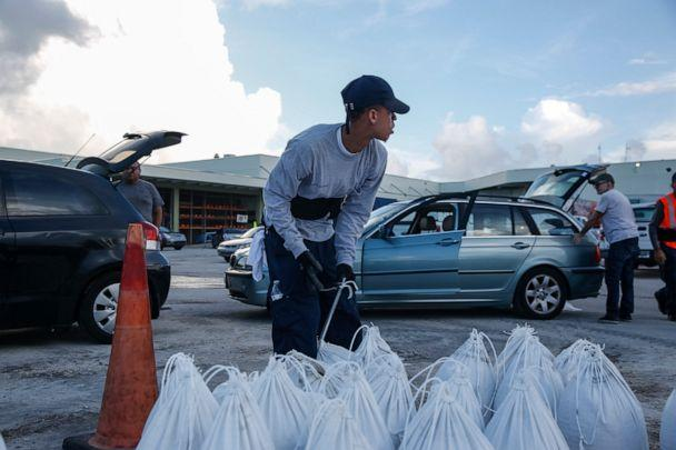 PHOTO: Miami Beach public works department workers fill sandbags and help load them into residents' cars in Miami Beach, Florida, August 31, 2019 in preparation for hurricane Dorian. (Adam Delgiudice/AFP/Getty Images)