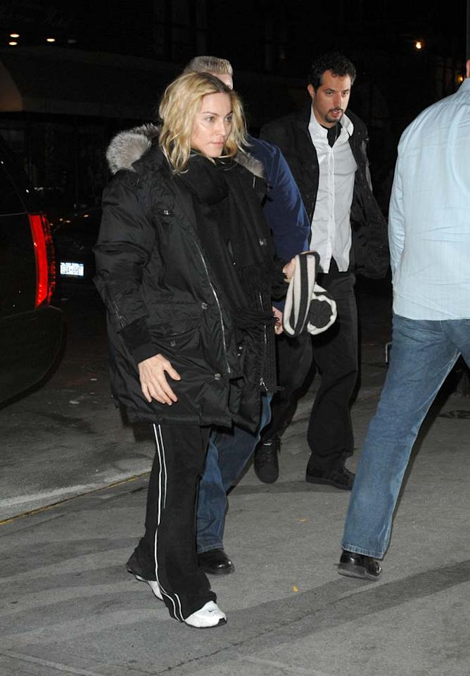 "Despite her recent divorce announcement, it was back to business for Madonna, who was spotted attending her weekly Kabbalah services in New York. Ron Asadorian/<a href=""http://www.splashnewsonline.com"" target=""new"">Splash News</a> - October 24, 2008"