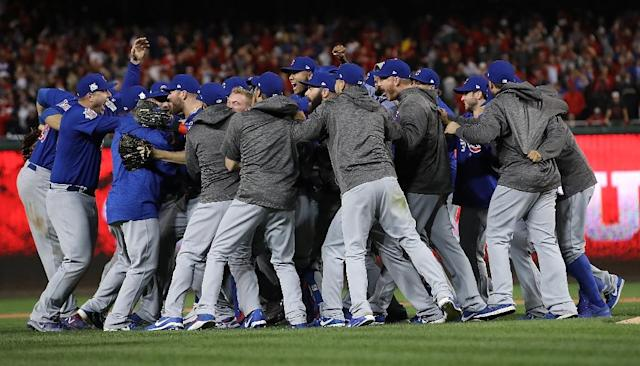 The Chicago Cubs celebrate after the final out of Game 5 of the National League Divisional Series, at Nationals Park in Washington, DC, on October 13, 2017 (AFP Photo/WIN MCNAMEE)