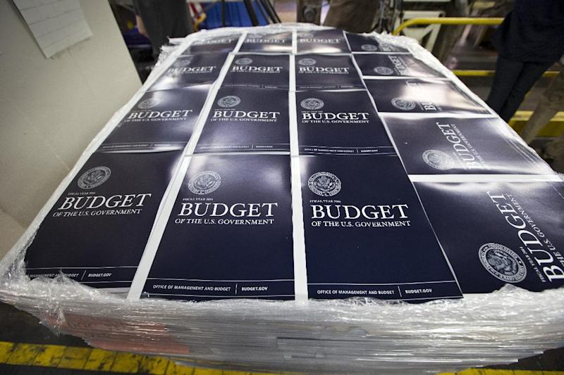 Copies of President Barack Obama's proposed federal budget plan for fiscal year 2014 are prepared for delivery at the U.S. Government Printing Office in Washington, Monday, April 8, 2013. (AP Photo/J. Scott Applewhite)
