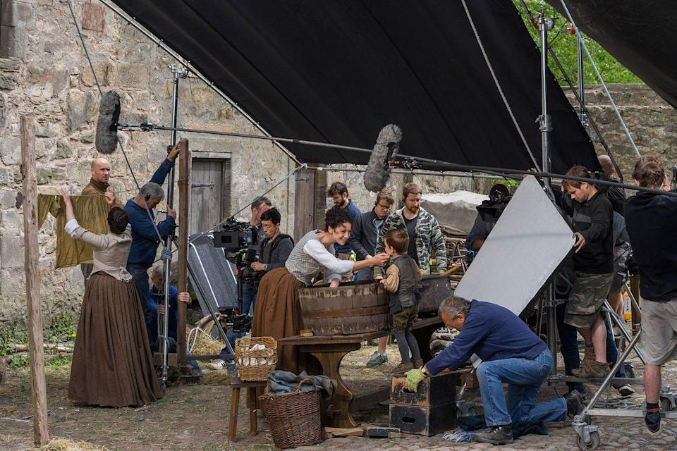 """<p>The crew pays attention to the smallest details to make sure every set reflects an 18th century setting. They even tweak <a href=""""https://www.vanityfair.com/hollywood/2016/10/inside-outlanders-hunt-for-claire-fraser"""" rel=""""nofollow noopener"""" target=""""_blank"""" data-ylk=""""slk:windows, roofs, and shutters."""" class=""""link rapid-noclick-resp"""">windows, roofs, and shutters.</a></p>"""