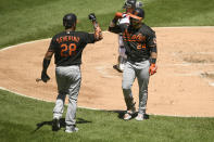 Baltimore Orioles' DJ Stewart (24) celebrates with teammate Pedro Severino (28) after hitting a solo home run during the third inning of a baseball game against the Chicago White Sox Sunday, May 30, 2021, in Chicago. (AP Photo/Paul Beaty)