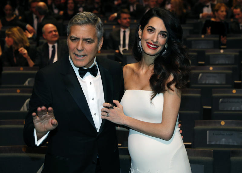 """Actor George Clooney, pictured with wife Amal Clooney, the respected internationalhuman rights lawyer, took a<a href=""""http://www.huffingtonpost.com/entry/george-clooney-edward-r-murrow_us_58b1c65be4b060480e0879f8?utm_hp_ref=george-clooney"""" target=""""_blank"""">thinly veiled swipe</a>at the U.S. president while attending theCesar Awards ceremony in Paris. (Philippe Wojazer / Reuters)"""