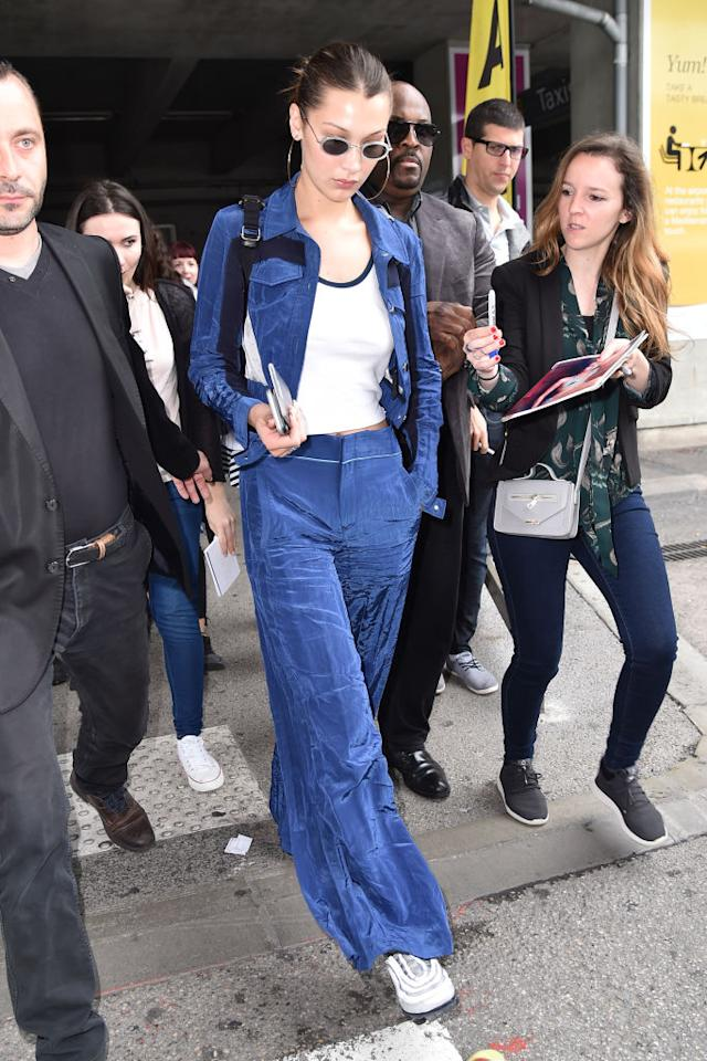 <p>Model Bella Hadid is seen during the 71st annual Cannes Film Festival at Nice Airport wearing a blue jacket and trouser set by Ovelia Transtoto in France on May 9, 2018. (Photo: Marc Piasecki/GC Images) </p>