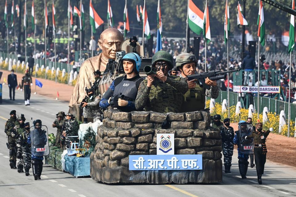 Police personnel march along a float representing the Central Reserve Police Force (CRPF) during the Republic Day parade in New Delhi on January 26, 2021. (Photo by Jewel SAMAD / AFP) (Photo by JEWEL SAMAD/AFP via Getty Images)