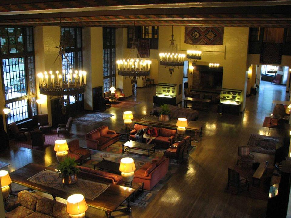 "<p>Visiting <a href=""https://www.nationalparkreservations.com/lodge/yosemite-ahwahnee-hotel/?gclid=EAIaIQobChMI_9LA--Sy6wIVEW-GCh3iGwqGEAAYASAAEgJNp_D_BwE#property-header-menu"" rel=""nofollow noopener"" target=""_blank"" data-ylk=""slk:the Ahwahnee"" class=""link rapid-noclick-resp"">the Ahwahnee</a>, formerly known as the Majestic Yosemite Hotel, is like stepping back in time. Built in 1927 at the base of Yosemite's iconic Half Dome, the hotel's signature design elements—lighting, stenciled beams, stained glass, and rich tapestries that reflect an amalgamation of influences from Art Deco and Native American to Middle Eastern and the Arts and Crafts movement—can still be seen today. The lodge's top-tier rooms feature balconies with stunning views.</p>"