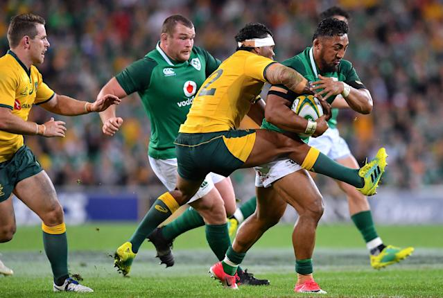 Rugby Union - June Internationals - Australia vs Ireland - Lang Park, Brisbane, Australia - June 9, 2018 - Bundee Aki of Ireland is tackled by Kurtley Beale of Australia. AAP/Darren England/via REUTERS ATTENTION EDITORS - THIS IMAGE WAS PROVIDED BY A THIRD PARTY. NO RESALES. NO ARCHIVE. AUSTRALIA OUT. NEW ZEALAND OUT.