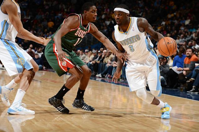 DENVER, CO - FEBRUARY 5: Ty Lawson #3 of the Denver Nuggets drives against the Milwaukee Bucks on February 5, 2014 at the Pepsi Center in Denver, Colorado. (Photo by Garrett W. Ellwood/NBAE via Getty Images)