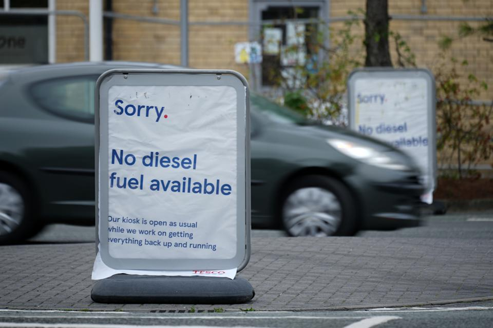 KNUTSFORD, UNITED KINGDOM - SEPTEMBER 28:  A sign declares no diesel available at a Tesco petrol station on September 28, 2021 in Knutsford, United Kingdom. The British government has temporarily exempted the oil industry from the Competition Act 1998, which will allow companies to share information and target fuel deliveries in parts of the country where retail supply is lowest.  The Royal Automobile Club (RAC) has said that fuel prices have also hit an eight year high due to the crisis with a 136.59p GBP average per litre of petrol. (Photo by Christopher Furlong/Getty Images)