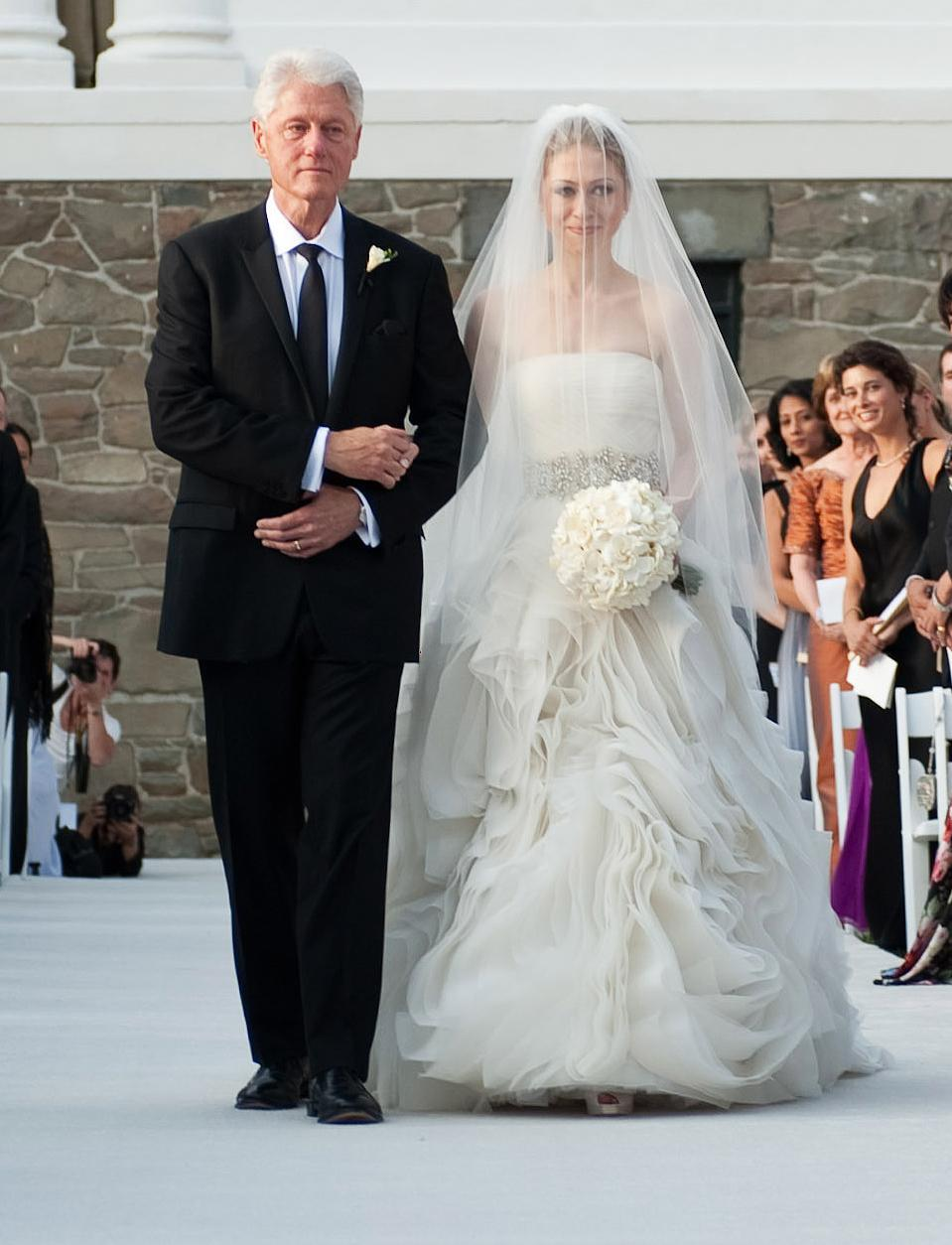 """<p>The First Daughter <a href=""""https://people.com/style/the-scoop-on-chelsea-clintons-wedding-gown-and-what-bill-and-hillary-wore/"""" rel=""""nofollow noopener"""" target=""""_blank"""" data-ylk=""""slk:donned a design by Wang (a friend of the family's)"""" class=""""link rapid-noclick-resp"""">donned a design by Wang (a friend of the family's)</a> for <a href=""""https://people.com/celebrity/chelsea-clintons-storybook-wedding/"""" rel=""""nofollow noopener"""" target=""""_blank"""" data-ylk=""""slk:her 2010 wedding to Mark Mezvinsky"""" class=""""link rapid-noclick-resp"""">her 2010 wedding to Mark Mezvinsky</a>. It featured a gathered silk organza skirt, draped tulle bodice and an embellished belt.</p>"""