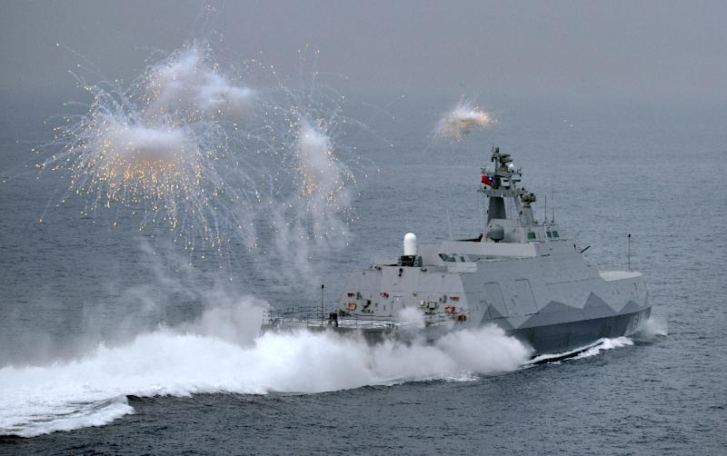 A domestic constructed guided missile corvette ship launches flares during a drill at sea near the naval port in Kaohsiung in southern Taiwan on January 27, 2016 (AFP Photo/Sam Yeh)