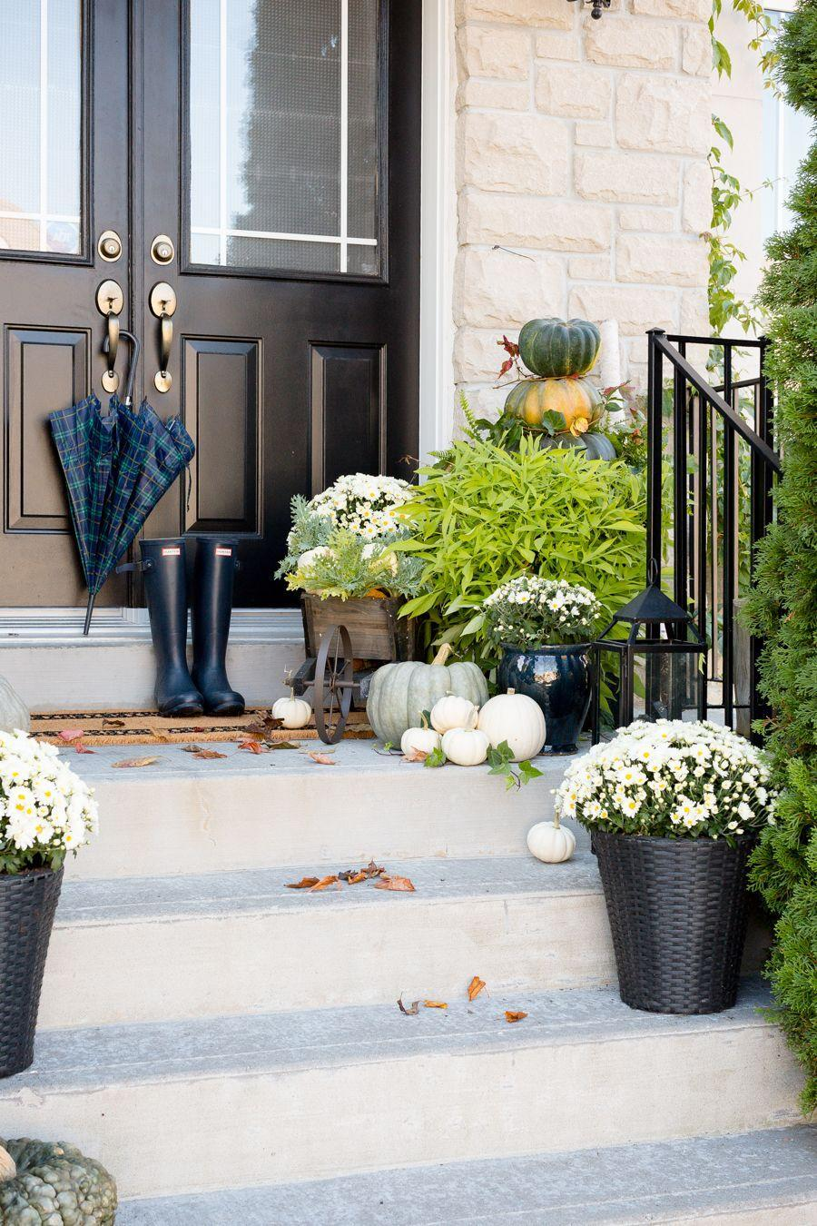 """<p>For a look that will last from Labor Day through Thanksgiving, steer clear of the expected orange color palette. Instead, look to sophisticated neutrals, like white, green, and even a little bit of black. </p><p><a class=""""link rapid-noclick-resp"""" href=""""https://www.craftberrybush.com/2017/09/fall-front-porch-3.html"""" rel=""""nofollow noopener"""" target=""""_blank"""" data-ylk=""""slk:GET THE TUTORIAL"""">GET THE TUTORIAL</a></p>"""
