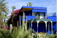 "<p>Equal parts botanical garden and artist's dream, <a href=""http://jardinmajorelle.com/ang/"" rel=""nofollow noopener"" target=""_blank"" data-ylk=""slk:Jardin Majorelle's"" class=""link rapid-noclick-resp"">Jardin Majorelle's</a> luminous blue buildings and 300 exotic plant species tells the story of its imaginative background. Jacques Majorelle, son of Art Nouveau furniture designer Louis Majorelle, spent nearly four decades crafting the landscape garden with plants from five continents such as cactus, yucca, jasmine, coconut trees, bamboo, and bougainvillea. Four years after Majorelle's death in 1980, French fashion designer Yves Saint Laurent saved the home and gardens from eager property developers and continued the preservation of the home's lush gardens.</p>"