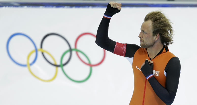 Gold medallist Michel Mulder from the Netherlands clenches his fist after his second heat race in the men's 500-meter speedskating race at the Adler Arena Skating Center during the 2014 Winter Olympics, Monday, Feb. 10, 2014, in Sochi, Russia