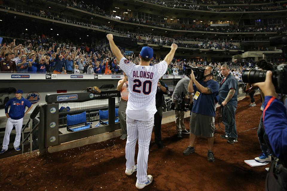 Sep 28, 2019; New York City, NY, USA; New York Mets first baseman Pete Alonso (20) celebrates with fans after defeating the Atlanta Braves and breaking the MLB rookie home run record at Citi Field. Mandatory Credit: Brad Penner-USA TODAY Sports