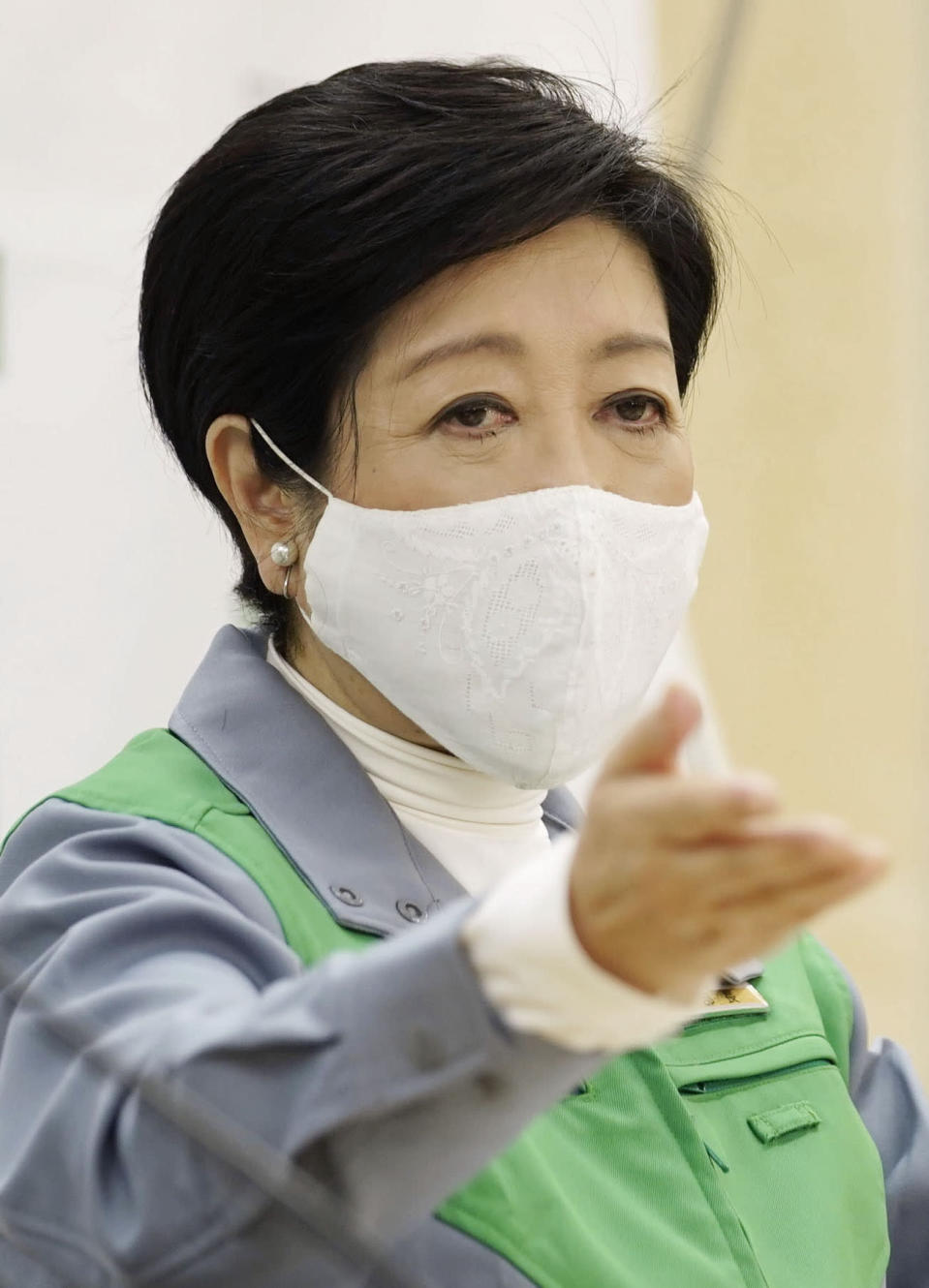Tokyo Gov. Yuriko Koike wearing a face mask speaks during an unscheduled news conference at Tokyo Metropolitan Government Building in Tokyo Wednesday, Dec. 30, 2020. Tokyo's ongoing upsurge is bigger than earlier infection waves and could turn explosive any time, Koike told, as the Japanese capital reported 944 new cases, its second highest since the pandemic began. (Chika Oshima/Kyodo News via AP)