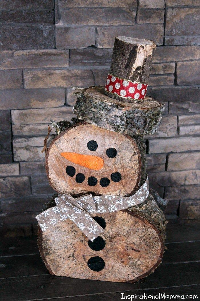 "<p>This durable snowman will last for many Christmases to come.</p><p><strong>Get the tutorial at <a href=""http://www.inspirationalmomma.com/diy-log-snowman/"" rel=""nofollow noopener"" target=""_blank"" data-ylk=""slk:Inspirational Momma"" class=""link rapid-noclick-resp"">Inspirational Momma</a>.</strong><br></p><p><a class=""link rapid-noclick-resp"" href=""https://www.amazon.com/Yards-Silv-Snowflake-Satin-Ribbon/dp/B015QUR09W?tag=syn-yahoo-20&ascsubtag=%5Bartid%7C10050.g.22825300%5Bsrc%7Cyahoo-us"" rel=""nofollow noopener"" target=""_blank"" data-ylk=""slk:SHOP RIBBON"">SHOP RIBBON</a></p>"