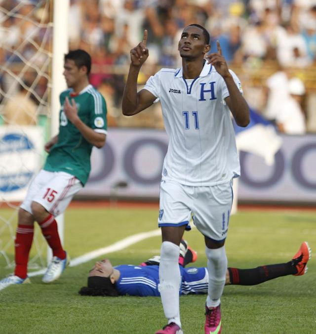 FILE - In this March 22, 2013, file photo, Honduras Jerry Bengtson, celebrates after scoring against Mexico during a 2014 World Cup qualifying soccer match in San Pedro Sula, Honduras. This is the third time in its history that Honduras qualifies for a World Cup. (AP Photo/Esteban Felix,File)