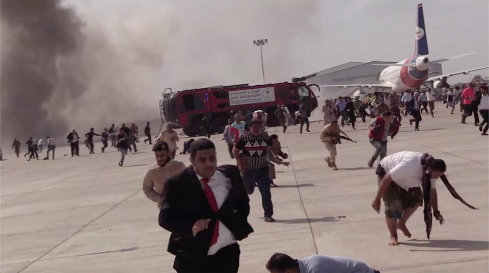 <p>People run following an explosion at the airport in Aden</p>AP