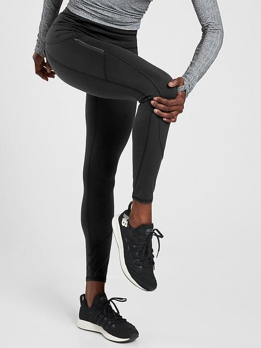 <p>Going for a run this fall and winter? The <span>Athleta Rainier Tight</span> ($98) is your go-to. It's lightweight and easy to move in but made with fabric that will keep you warm.</p>