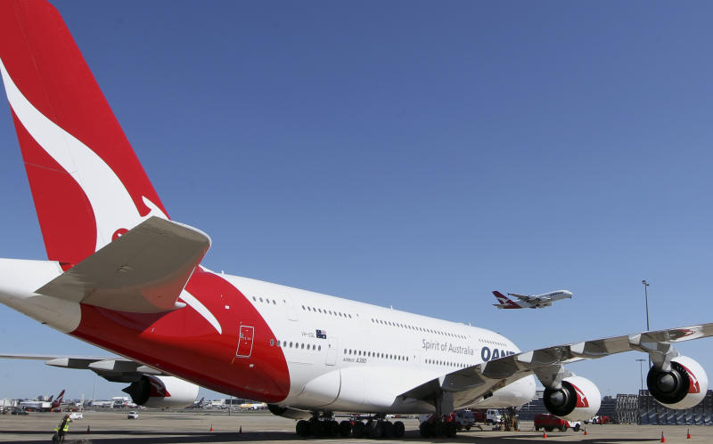 A Qantas A-380 takes off in Sydney, Australia, Thursday, Sept. 6, 2012. Qantas Airways Ltd. announced Thursday that it has signed a 10-year partnership deal with rival Emirates in a bid to boost the Australian airline's struggling international division. The deal is subject to regulatory approval. (AP Photo/Rob Griffith)