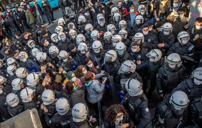 Turkish police officers detain protestors during a rally in support of Bogazici University students protesting against the appointment of a ruling Justice and Development Party (AKP) loyalist as rector on February 4, 2021