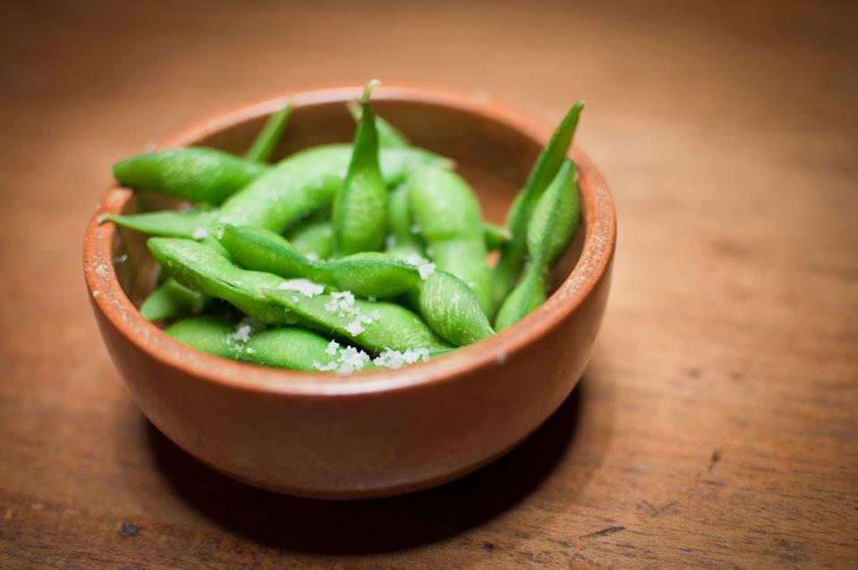 "<p>OK, edamame is technically a legume, not a vegetable, but it's still a nutrient-rich plant-based snack that's great for weight loss. ""Just one cup of edamame has 17 grams of protein and eight grams of fiber,"" said Claire Virga, MS, RDN, of <a href=""https://www.rootedwellness.com/#recipes"" class=""link rapid-noclick-resp"" rel=""nofollow noopener"" target=""_blank"" data-ylk=""slk:Rooted Wellness"">Rooted Wellness</a>. That, plus its unsaturated fat content, ""makes it the ideal snack for long-lasting satiety,"" Claire told POPSUGAR. Jodi Greebel, a registered dietitian at <a href=""https://www.citrition.com/"" class=""link rapid-noclick-resp"" rel=""nofollow noopener"" target=""_blank"" data-ylk=""slk:Citrition"">Citrition</a>, recommended heating up some edameme with a pinch of sea salt for extra taste.</p>"