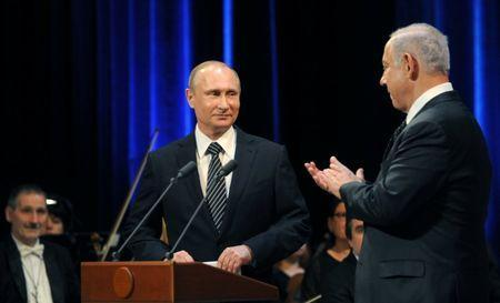 File photo: Russian President Vladimir Putin (L) and Israeli Prime Minister Benjamin Netanyahu attend a concert, dedicated to the 25th anniversary of the restoration of diplomatic relations between the two countries at the Bolshoi Theatre in Moscow, June 7, 2016. Sputnik/Kremlin/Mikhail Klimentyev/via REUTERS