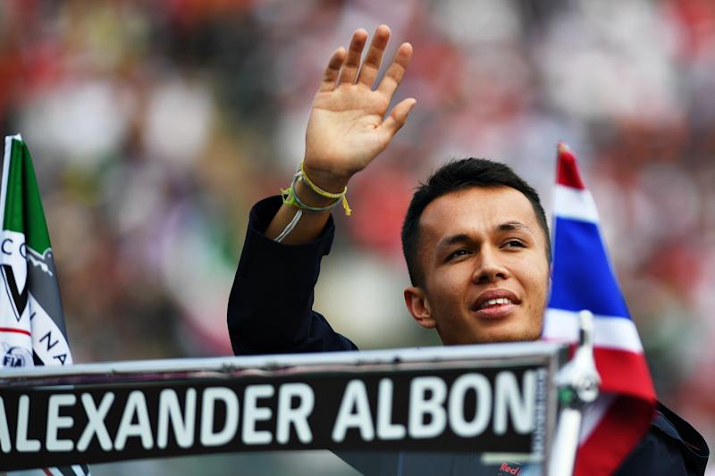 MEXICO CITY, MEXICO - OCTOBER 27: Alexander Albon of Thailand and Red Bull Racing waves to the crowd on the drivers parade before the F1 Grand Prix of Mexico at Autodromo Hermanos Rodriguez on October 27, 2019 in Mexico City, Mexico. (Photo by Clive Mason/Getty Images)