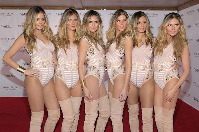<p>The model decreed there would be no prosthetics and heavy makeup for her in 2016. Instead she enlisted five look-alikes and went to her own Halloween bash as Heidi and her five clones. Genius. (Photo: Neilson Barnard/Getty Images for Heidi Klum) </p>