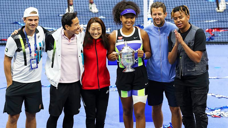 Naomi Osaka, pictured here celebrating her US Open triumph with her team.