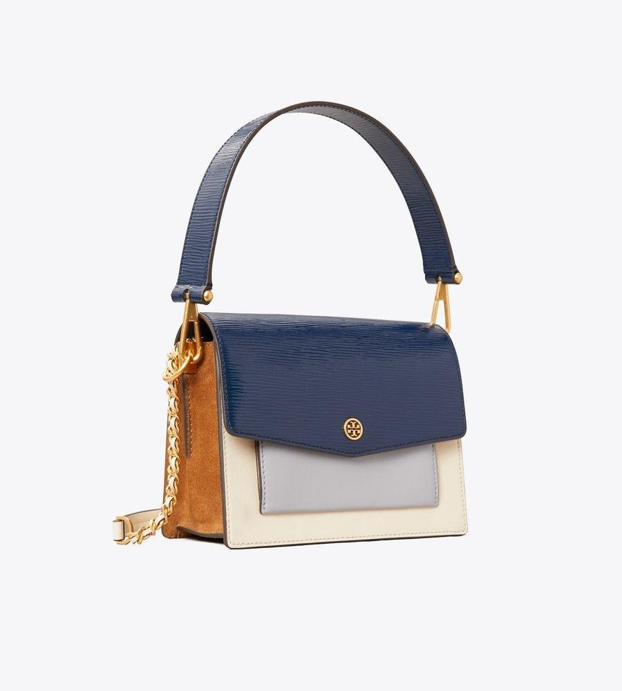 """<p>toryburch.com</p><p><strong>$269.00</strong></p><p><a href=""""https://go.redirectingat.com?id=74968X1596630&url=https%3A%2F%2Fwww.toryburch.com%2Fen-us%2Fhandbags%2Fshoulder-bags%2Frobinson-color-block-convertible-shoulder-bag%2F74610.html&sref=https%3A%2F%2Fwww.townandcountrymag.com%2Fstyle%2Fg37340584%2Fshop-the-best-deals-from-tory-burchs-private-sale%2F"""" rel=""""nofollow noopener"""" target=""""_blank"""" data-ylk=""""slk:Shop Now"""" class=""""link rapid-noclick-resp"""">Shop Now</a></p><p><strong><del>$468</del> $269 (43% off)</strong></p><p>Expect to receive a bunch of compliments on this cool, colorblocked style. </p>"""